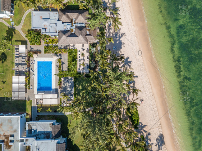 Aerial view of residential area with pool on beachfront,  Mauritius