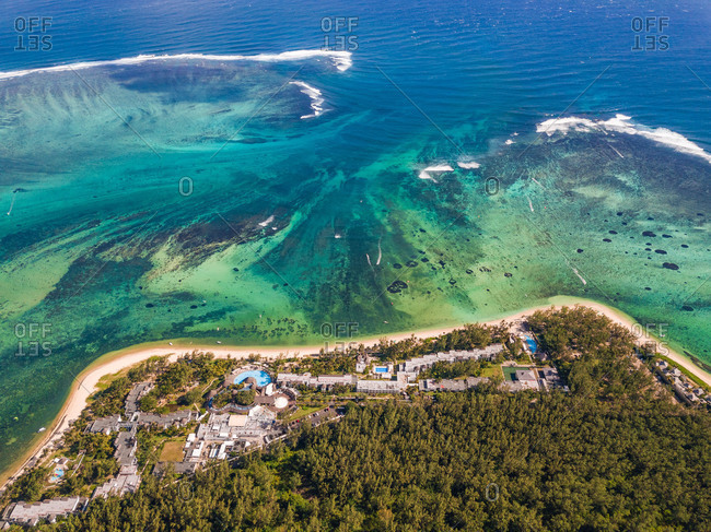 Aerial view of resort in front of coral reef, Mauritius.