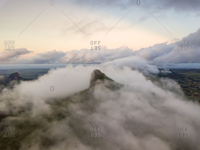 Aerial view of cloudy Le Pouce Mountain Peak in Moka District, Mauritius