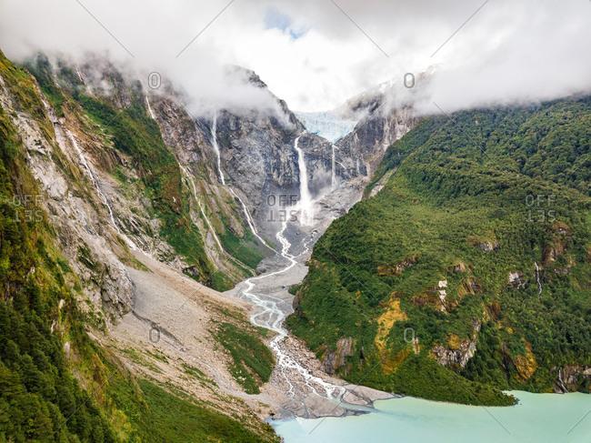 Aerial view of misty waterfall in Cisnes, Region de Aysen, Chile