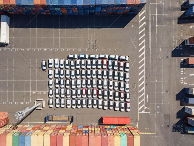 Aerial view of cars parked among shipping containers, Reunion island.