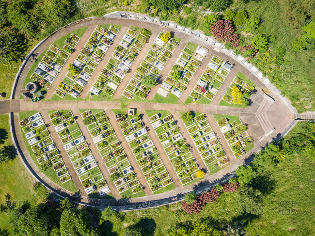 Aerial close up view of leaf shaped cemetery Cimetiere Paysager, Le Port, Reunion.