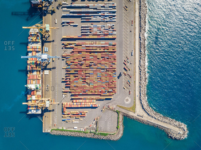April 11, 2018: Aerial view of cargo ships and shipping containers in harbor, Reunion island.
