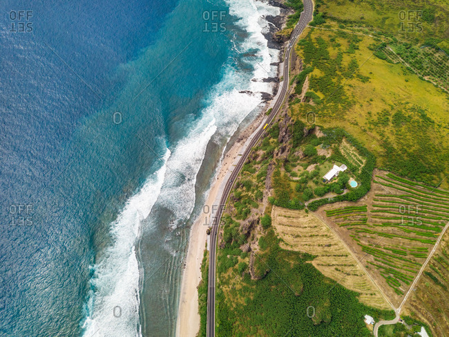Aerial view of coastal road and swimming pool by Indian Ocean, Reunion island.