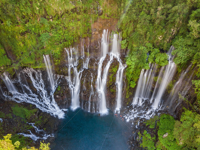Aerial view of waterfalls and people canyoneering in Reunin island.