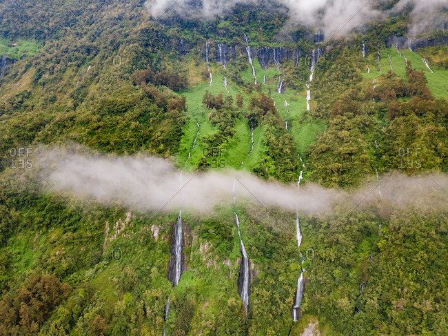 Aerial view of misty Voile de la Mariee waterfall, Reunion island.