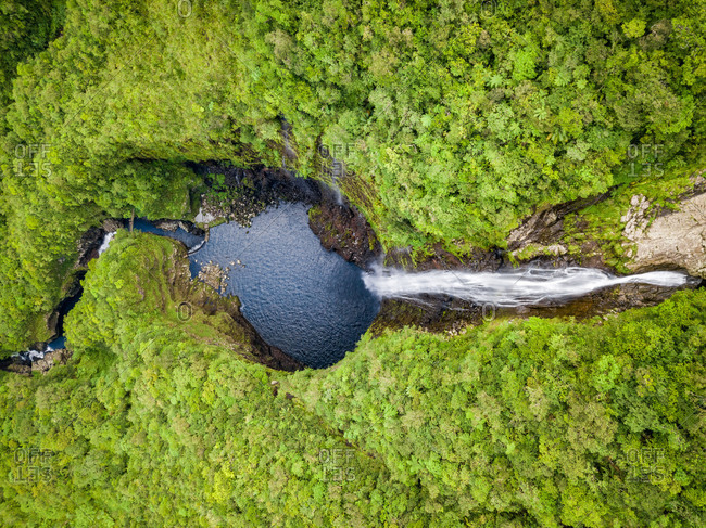 Aerial view of waterfall in Foret Departementale du Cratere, Reunion.