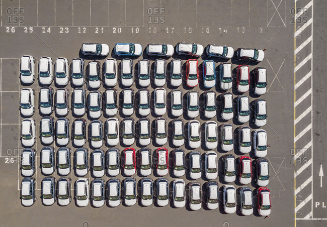 Aerial view of rows of white cars parked orderly in Le Port, Reunion.