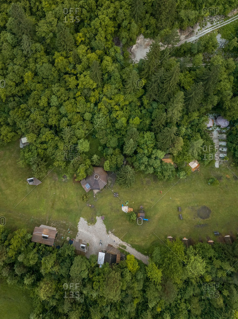 Aerial view of a summer camp with tents located in a valley near the Soca River.