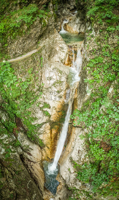 Aerial view of high waterfall surrounded by a lot of vegetation in Soca river.