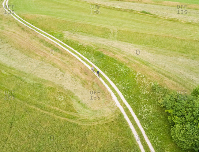 Aerial view of cyclists on a dirt track in Soca valley, Slovenia.