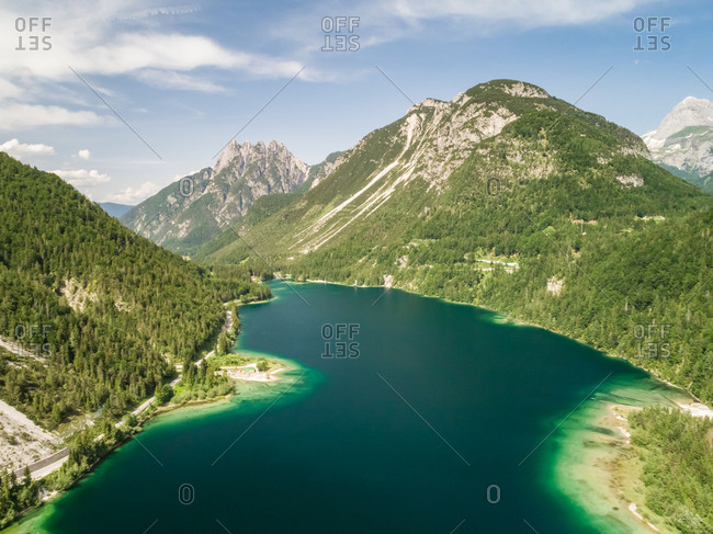 Aerial view of Lago del Predil lake surrounded by mountains, Italy.