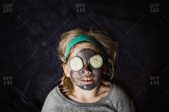 Little girl wearing a mud mask