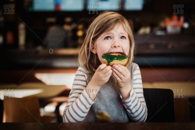 Girl eating a holiday donut