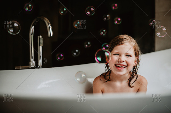 Little girl enjoying her bubble bath