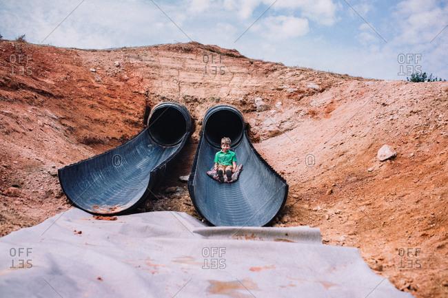 Boy going down a gigantic slide