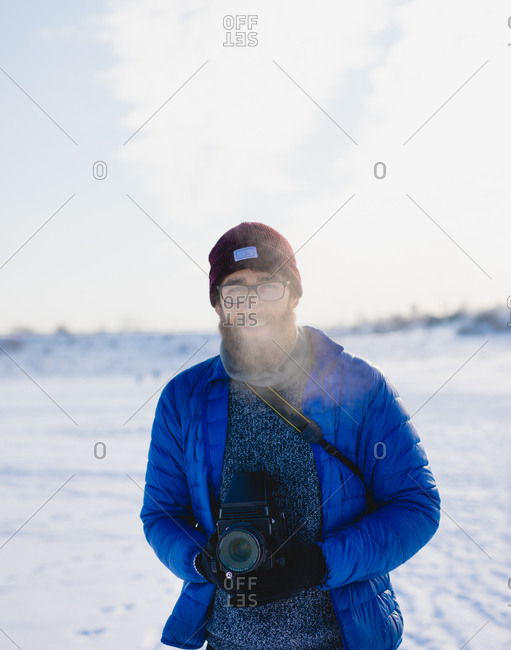 A guy with a camera in a cold climate