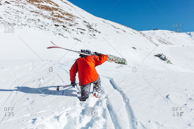 Skier in a red jacket in the French Alps