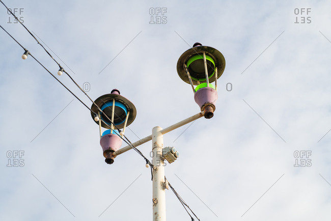Low angle view of streetlamps and stringed lights