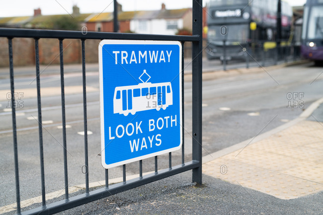 Sign for tramway at crosswalk on street