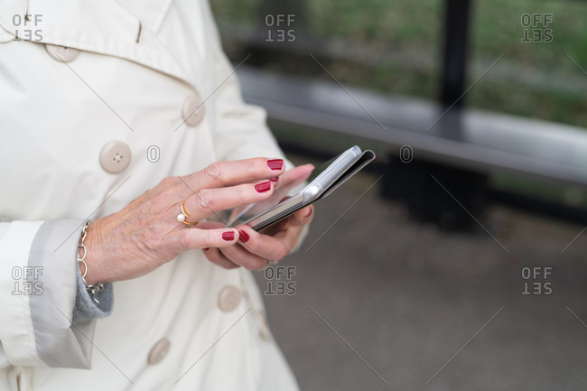 Close-up of senior woman using her smartphone