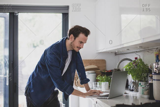 Adult male working from home in kitchen