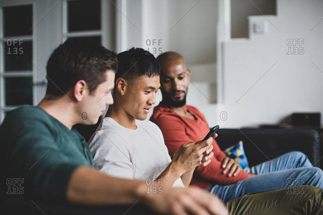 Male friends looking at smartphone together