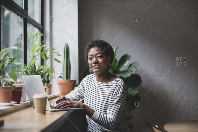 Portrait of a freelance african american businesswoman working in a cafe