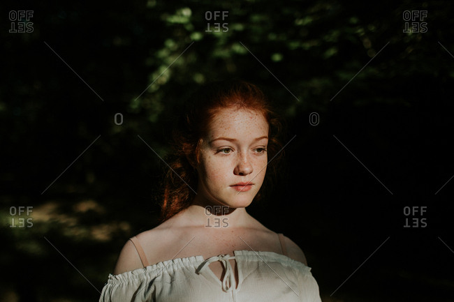 Portrait of a redheaded girl wearing off-shoulder blouse