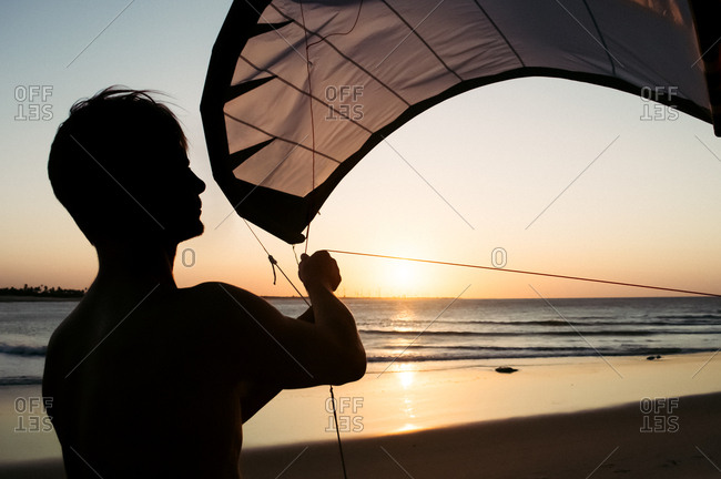 Close -up of man with kite surfing sail