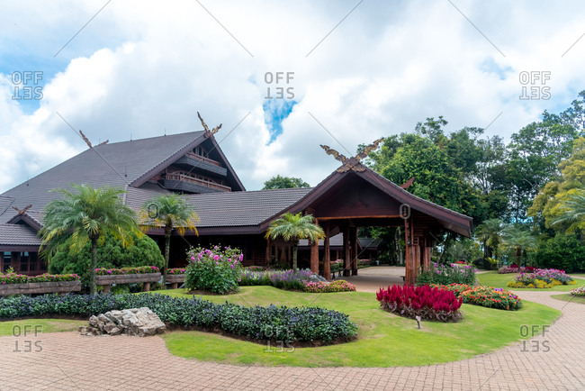 June 3, 2018: Exterior view of Doi Tung Royal Villa building in beautiful tropical garden with lush vegetation, Thailand