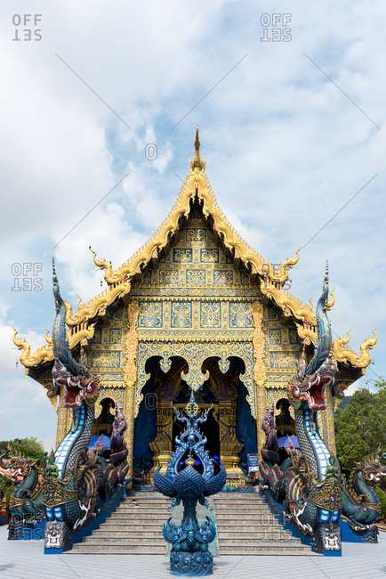 June 5, 2018:Colorful ornamental exterior of Wat Rong Suea Ten (also known as Blue Temple) with beautiful design against blue sky, Chiang Rai