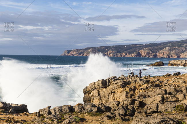 Rocky Atlantic coast with high surf and Cabo da Roca in the background, Sintra-Cascais Nature Park, Sintra, Greater Lisbon, Portugal