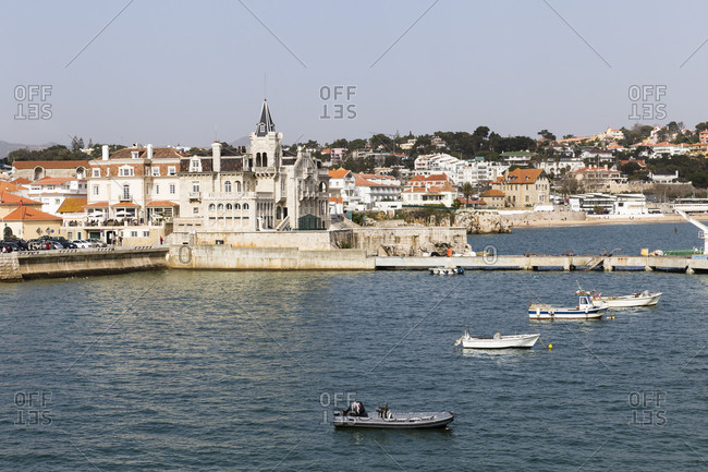 Moored boats in the harbor with city in background, Cascais, Greater Lisbon, Portugal