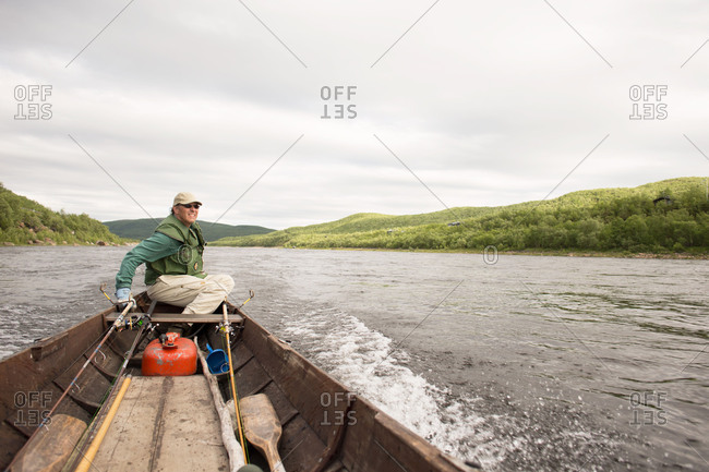 August 30, 2017: Fisher man with boat on the Tana river, Utsjoki, Lapland