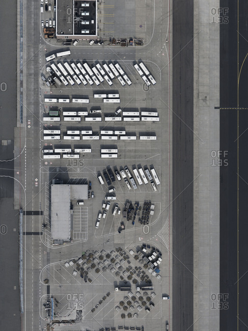 Aerial view buses and cars parked at airport