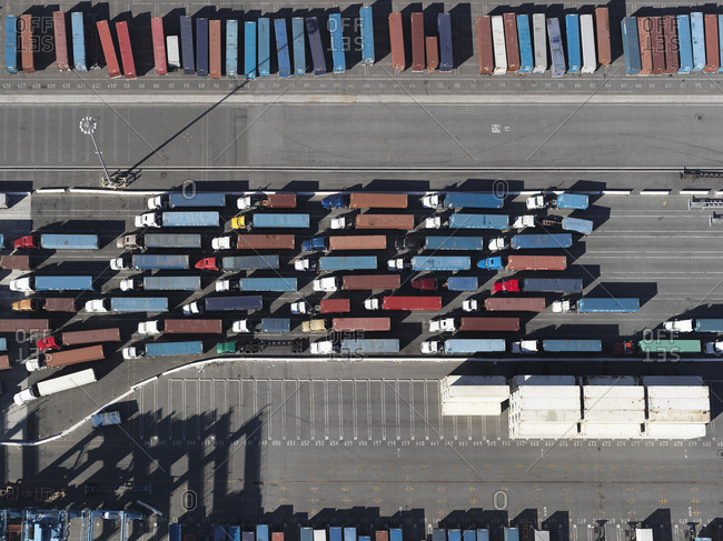May 29, 2018: Aerial view semi trucks with containers in sunny shunting yard, Los Angeles, California, USA