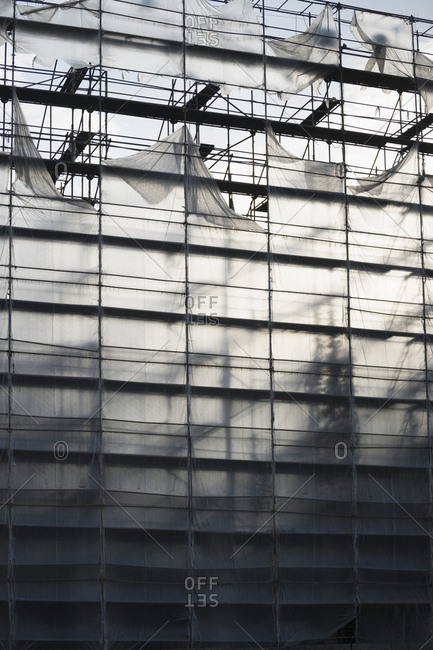 Protective sheeting over high-rise building under construction