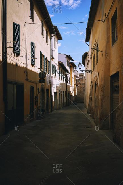 Tranquil alley between buildings, Borga San Lorenzo, Tuscany, Italy
