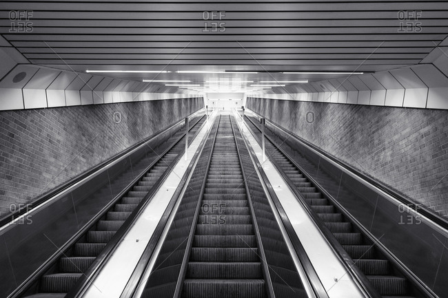Black and white of ascending escalator