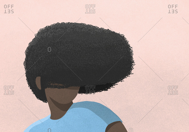 Woman's afro covering face on pink background