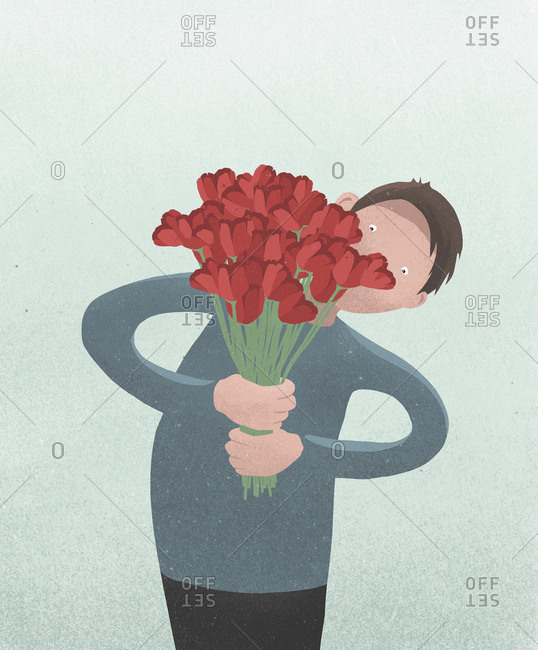 Man holding Valentines Day red tulip bouquet