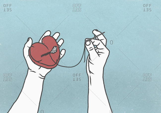 Hands sewing broken heart with needle and thread