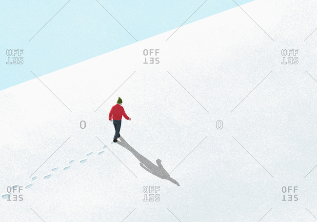 Man walking up snowy slope