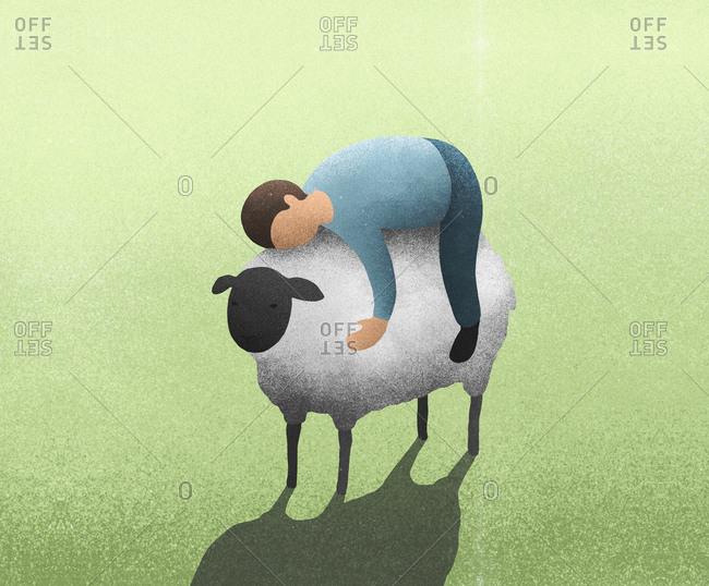 Man laying on top of lamb