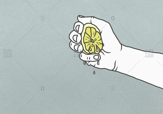 Man squeezing juicy lemon