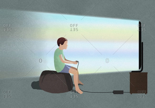 Boy playing video game at TV