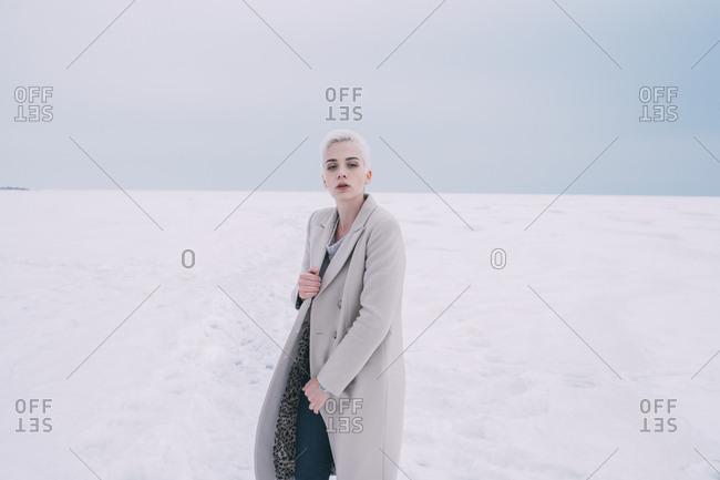 Portrait confident young woman in snowy landscape