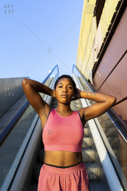 Young sportive woman on escalator