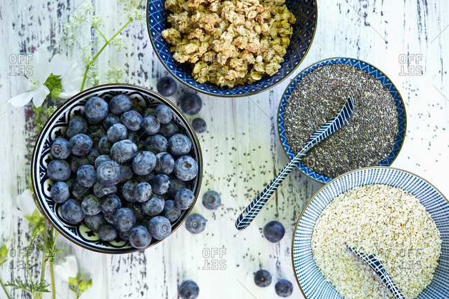 Bowls of granola- blueberries- black chia seeds and amaranth